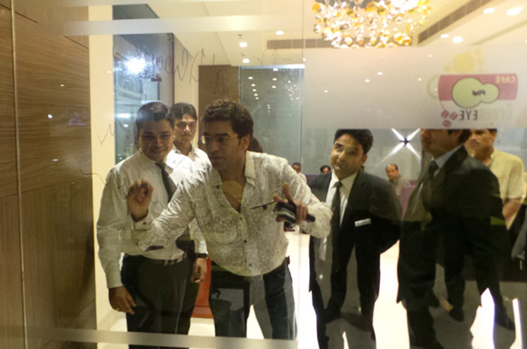 Actor Ashutosh Rana Giving Signature on Wall Glass